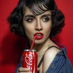 Girl sipping Coca Cola